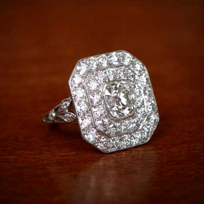 Antique Cushion Cut Diamond on Wooden Desk Background
