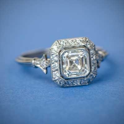 Asscher Cut Diamond Ring on Blue Background