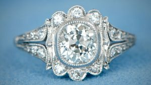 Cushion cut engagement ring with filigree