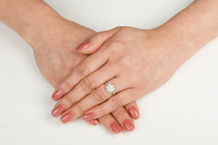 11359-Madrid-Halo-Engagement-Ring-on-Finger