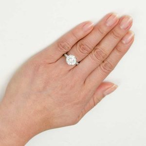 5ct engagement ring on a finger