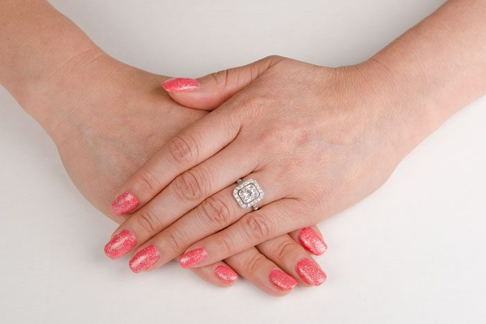 GS163-Cushion-Halo-Engagement-Ring-on-Finger