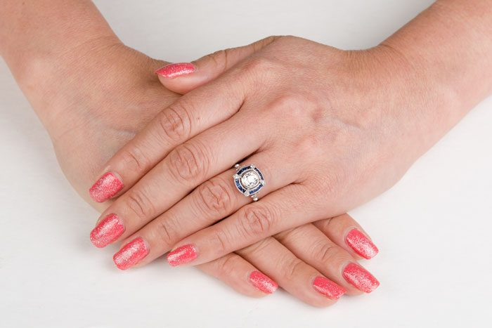 11193VB-Diamond-and-Sapphire-Engagement-Ring-on-Finger