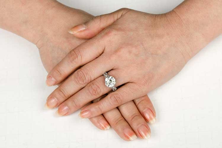 4 carat diamond engagement ring on finger