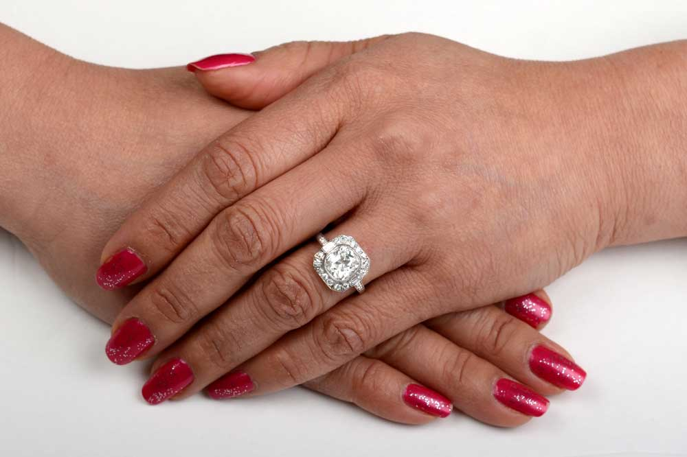 Cushion cut engagement rings on finger