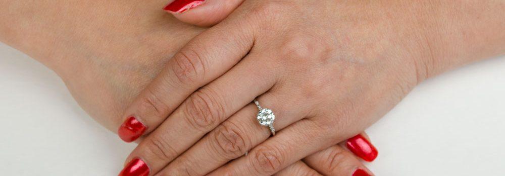 Diamond Engagement Ring on Finger