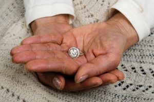 Holding Engagement Ring in Hand