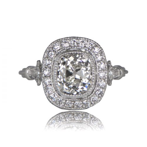 Cushion cut diamond engagement ring with old mine halo
