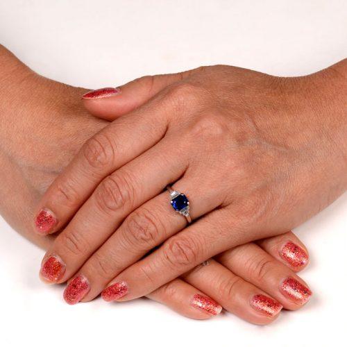 Sapphire Ring on Finger of Hand
