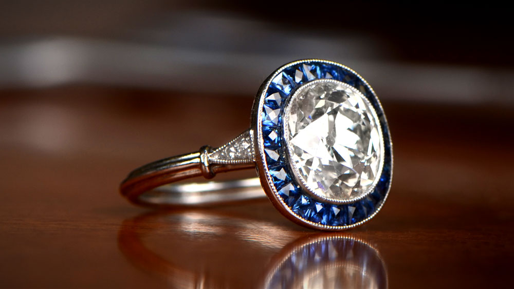 Diamond Engagement Ring on Blue Surface