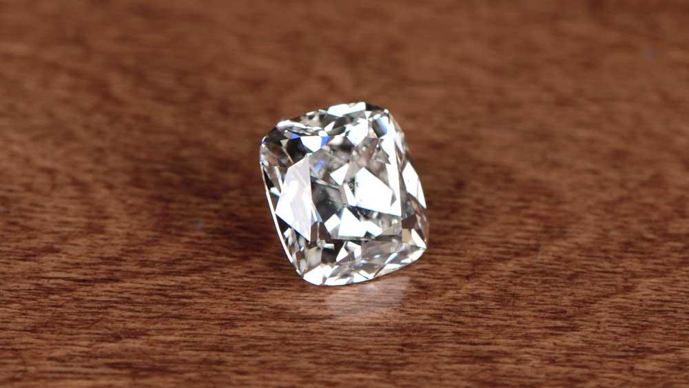 Cushion Cut Diamond On Table Surface