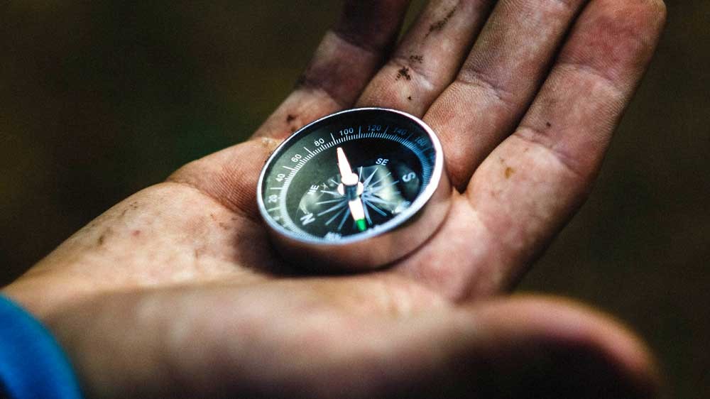 Man holding Compass