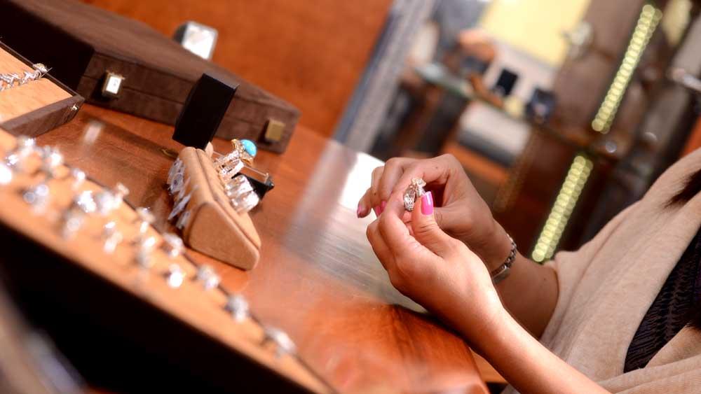 Customer Examining Engagement Ring in Showroom