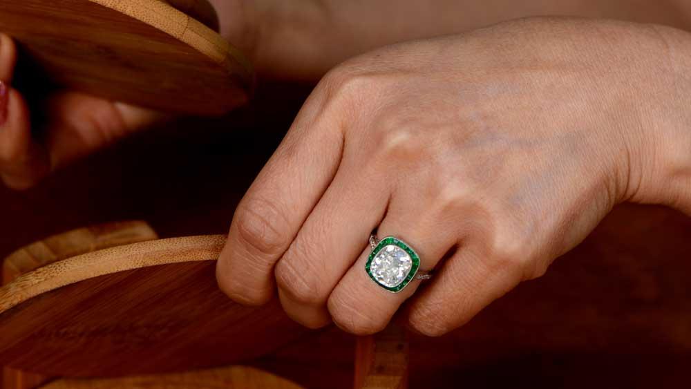 Lady wearing 4 carat diamond ring on finger