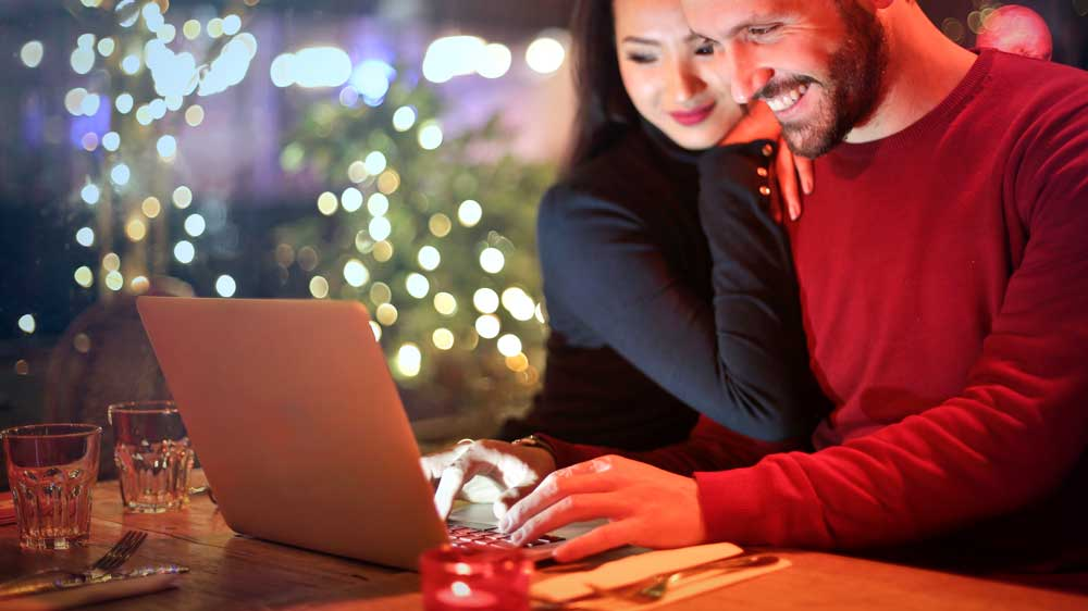 Couple Buying Engagement Ring Online
