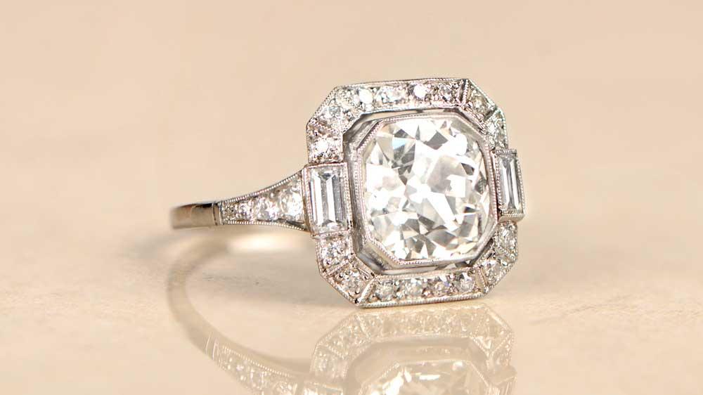Diamond Engagement Ring on Reflective Surface