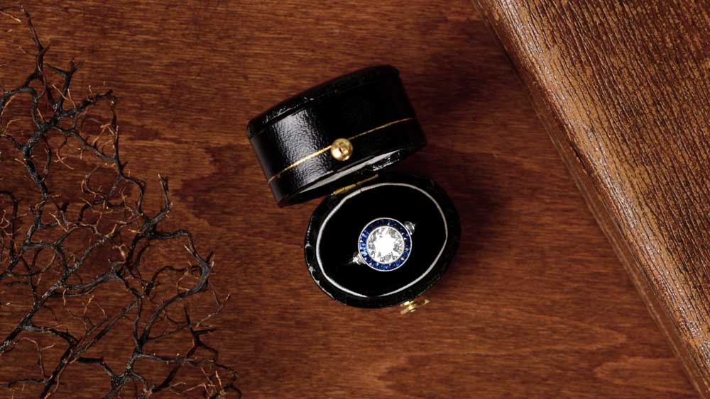 Diamond and Sapphire Engagement Ring on Wood