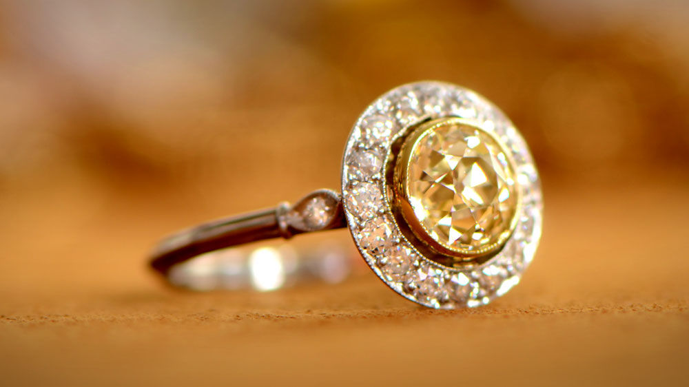 Fancy Yellow Diamond Halo Engagement Ring